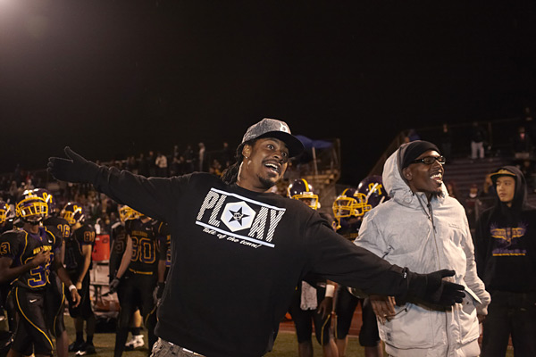 Lynch on the sideline during a game game of his alma mater, Oakland Technical High, in Nov. 2012. (Deanne Fitzmaurice/SI)