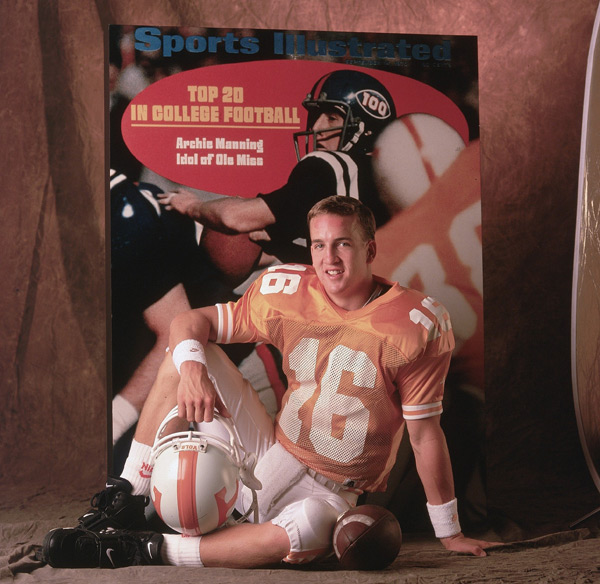 Peyton poses with a Sept. 14, 1970 Sports Illustrated cover depicting his father, Archie Manning, who played quarterback at Ole Miss. (Bill Frakes/SI)