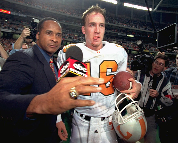 After leading his team to victory in the SEC Championship game, Peyton talks with ABC reporter Lynn Swann. (Bob Rosato/SI)