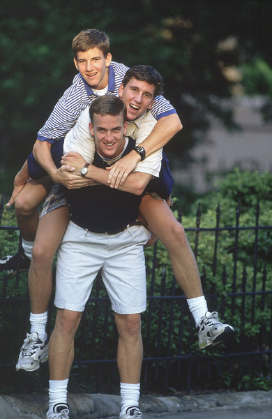 Peyton carries his older brother Cooper and his younger brother Eli on his back. (Bill Frakes/SI)