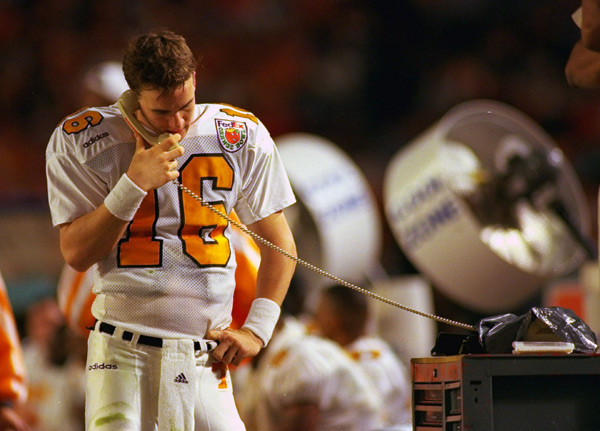 Manning talks on the phone on the Tennessee sideline during the 1998 Orange Bowl game against Nebraska. The Volunteers lost, 42-17. (Al Tielemans/SI)