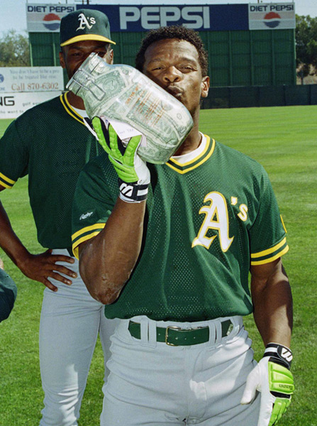 Rickey Henderson and Jar of Money :: AP