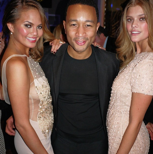 @mj_day:                        @johnlegend sandwich with #siswim50 cover models @chrissyteigen @ninaagdalFollow