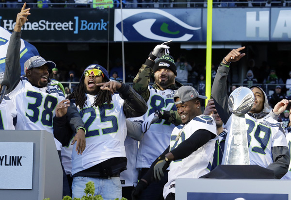 Chandler Fenner (38), Richard Sherman (25), Kellen Davis (87), Christine Michael (33) and Doug Baldwin (89) :: AP