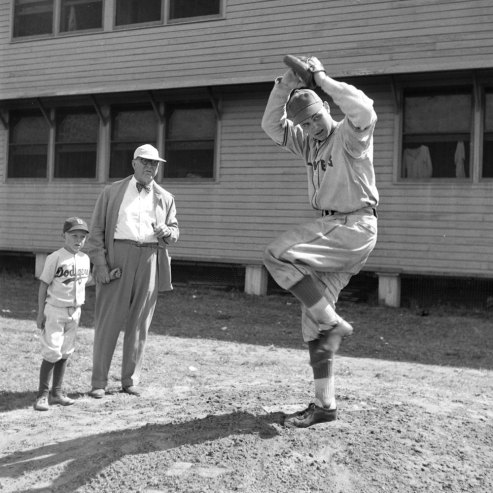 Dodgers general manager Branch Rickey and his grandson sizing up a pitcher's delivery. (George Silk—Time & Life Pictures/Getty Images)