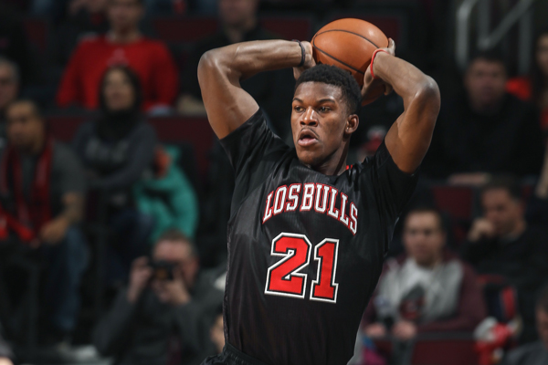 "Jimmy Butler wears a ""Los Bulls"" sleeved jersey. (Gary Dineen/Getty Images)"