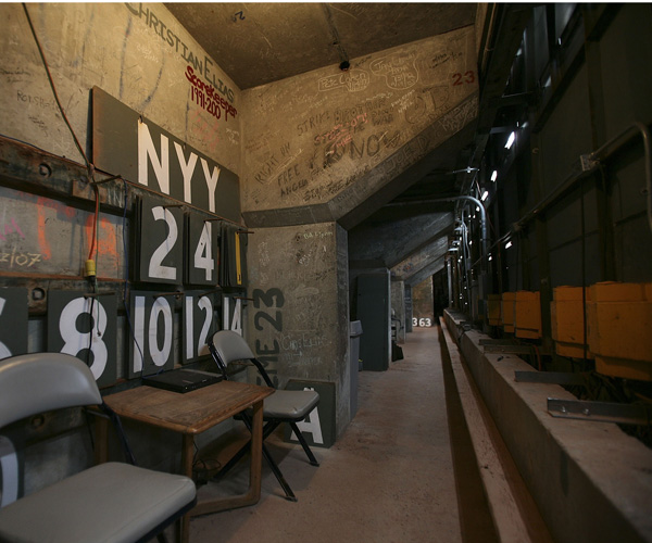 A view of the numbers used for the manual scoreboard are seen in the room behind the green monster (Photo by Jed Jacobsohn/Getty Images).