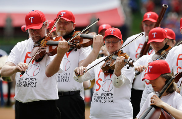 The Fort Worth Symphony Orchestra performs before the Rangers-Phillies game. (AP Photo/Tony Gutierrez)