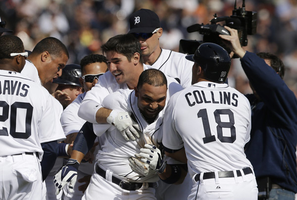 Alex Gonzalez is mobbed by teammates after his game-winning single. (AP Photo/Carlos Osorio)