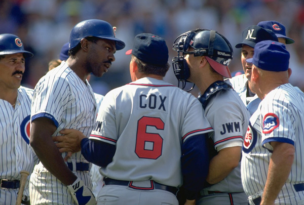 Andre Dawson argues with Greg Olson and Bobby Cox during a 1991 Cubs-Braves game. (John Biever/SI)