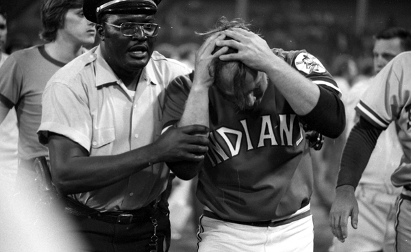 Indians pitcher Tom Hilgendorf is helped off the field after suffering a minor injury. (Getty Images)