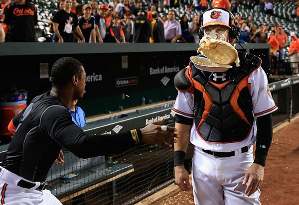 Caleb Joseph is drilled with a pie by teammate  Adam Jones. (Getty Images)