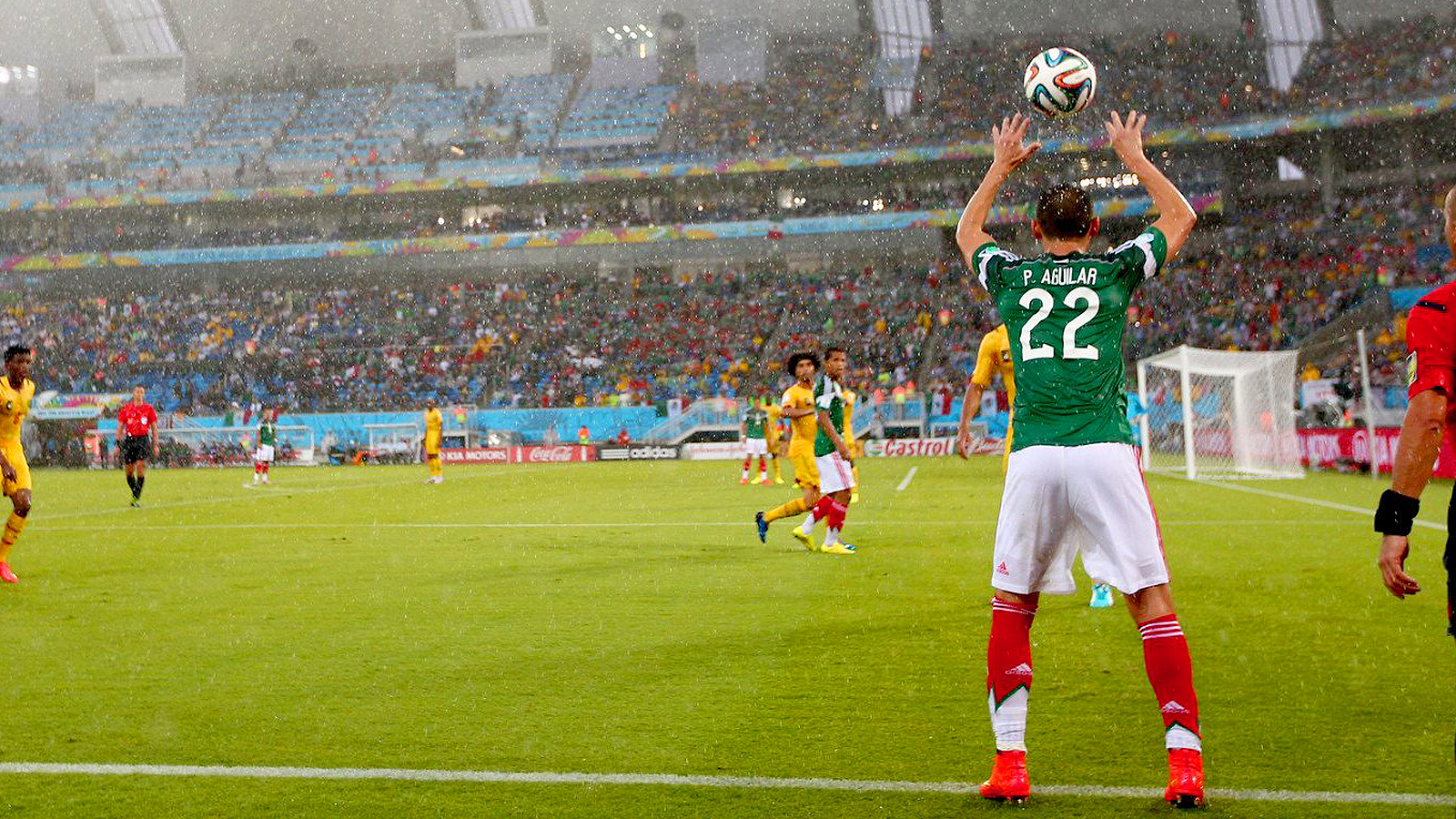 Spectators were not immune to the rain in Mexico's soggy 1-0 victory over Cameroon.
