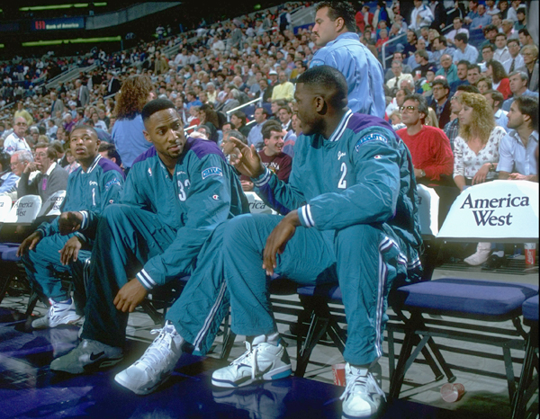 Alonzo Mourning and Larry Johnson :: John W. McDonough/SI
