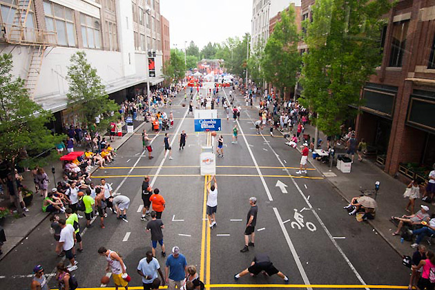 Hoopfest officials use eight miles of road tape to block off courts for the nearly 7,000 teams that participate.