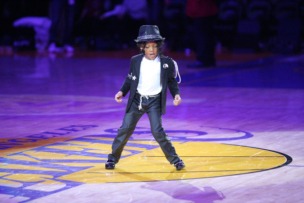 A young Michael Jackson impersonator performs during a 2011 Lakers-Celtics game. (Icon SMI)