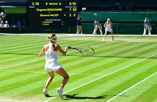 Simona Halep (right) jumped up to a 2-1 lead against Eugenie Bouchard in the first set of their semifinal match at Wimbledon.