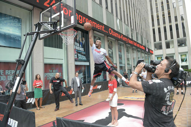 Taurian Fontenette (a.k.a. - Air Up There) dunks over Elisabeth Hasselbeck during an appearance on Fox & Friends.
