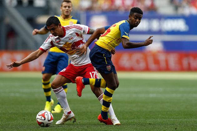 Gedion Zelalem gets tangled up with Tim Cahill in Arsenal's 1-0 loss to the New York Red Bulls in Saturday's friendly.
