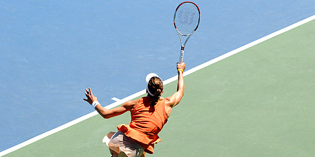 Andrea Petkovic returns a ball to Serena Williams on Day 6 of the Bank of the West Classic.