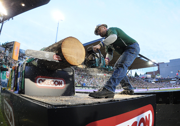 Timber Joey slices a log slab after a Portland Timbers goal at Providence Park.