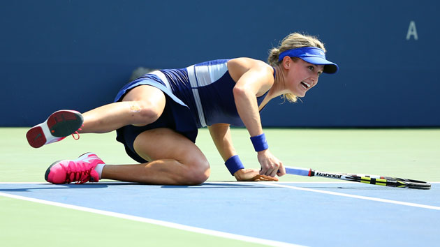 Eugenie Bouchard fell to the ground after winning her first-round match with Olga Govortsova.