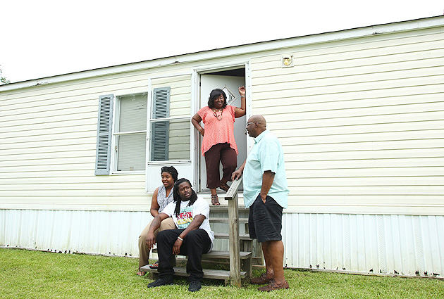 Eddie Lacy (bottom) built a new house for his family, just seven minutes from the trailer they lived in before.