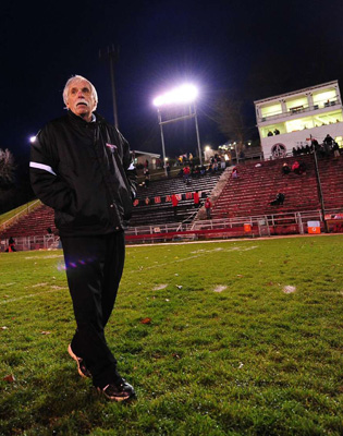 Mike Zmijanac never played a down of football, but he's the winningest coach in program history.
