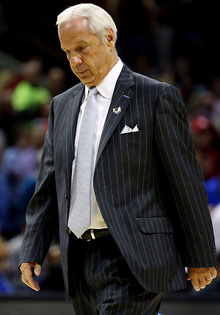 Men's basketball coach Roy Williams was not implicated of wrongdoing in the Wainstein Report, but serious charges by a former player, Rashad McCants, remain unresolved.