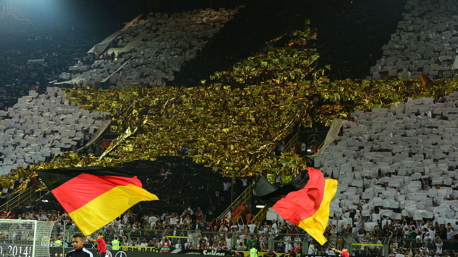 German fans boast the newest star earned by the national team, symbolizing its 2014 World Cup triumph, at a Euro 2016 qualifying match in Dortmund.