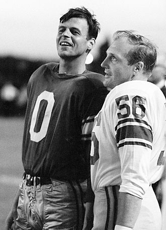 George Plimpton (left) could finally relax after defenders like Joe Schmidt were done having their way with him.
