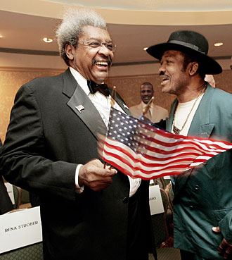 Don King once promoted Joe Frazier's fights, but now it was the ex-champ's turn to get some punches in.