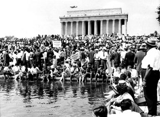 Many in the crowd at the Lincoln Memorial cooled off by dipping their feet in the Reflecting Pool.