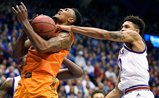 Kelly Oubre (right) helped Kansas start a four-game stretch against ranked teams by beating Le'Bryan Nash and Oklahoma State on Tuesday.