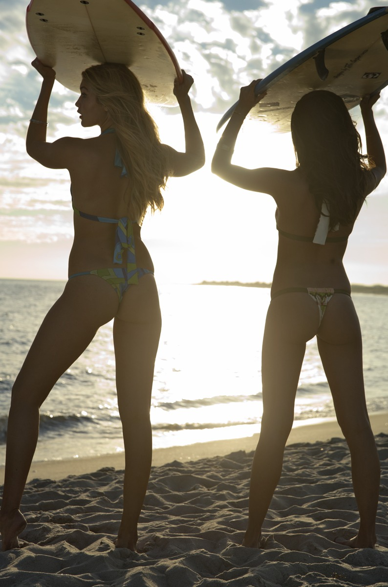 Gigi Hadid and Sara Sampaio were photographed by Ben Watts at the Jersey Shore. Swimsuits by Ola Vida.