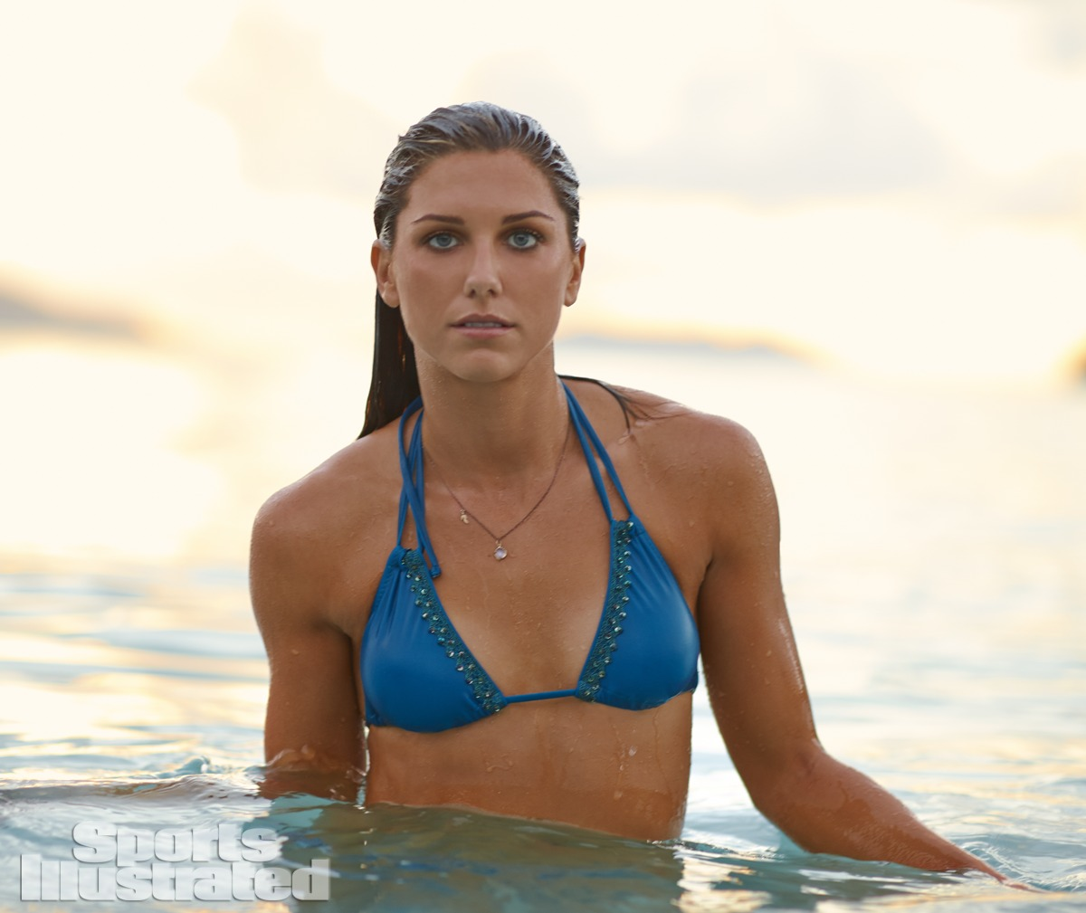Alex Morgan was photographed by Adam Franzino in Guana Island. Swimsuit by Kate Swim.