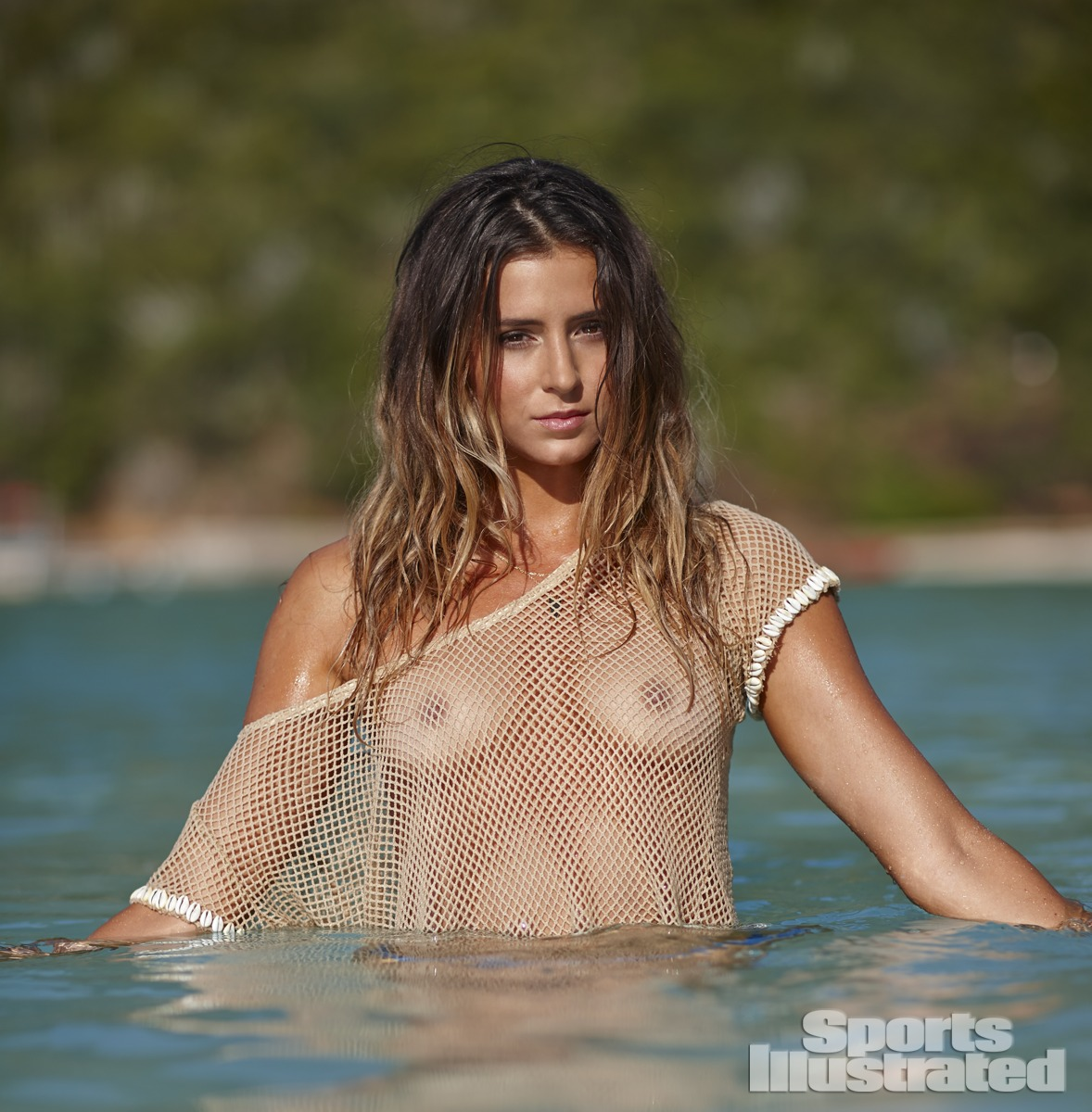 Anastasia Ashley was photographed by Adam Franzino in Guana Island. Swimsuit by MIKOH, Top by Aila Blue.