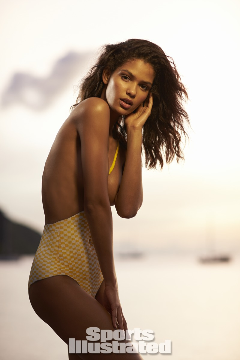Cris Urena was photographed by Walter Iooss Jr. in St. Lucia. Swimsuit inspired by the 1967 Rudi Gernreich suit.