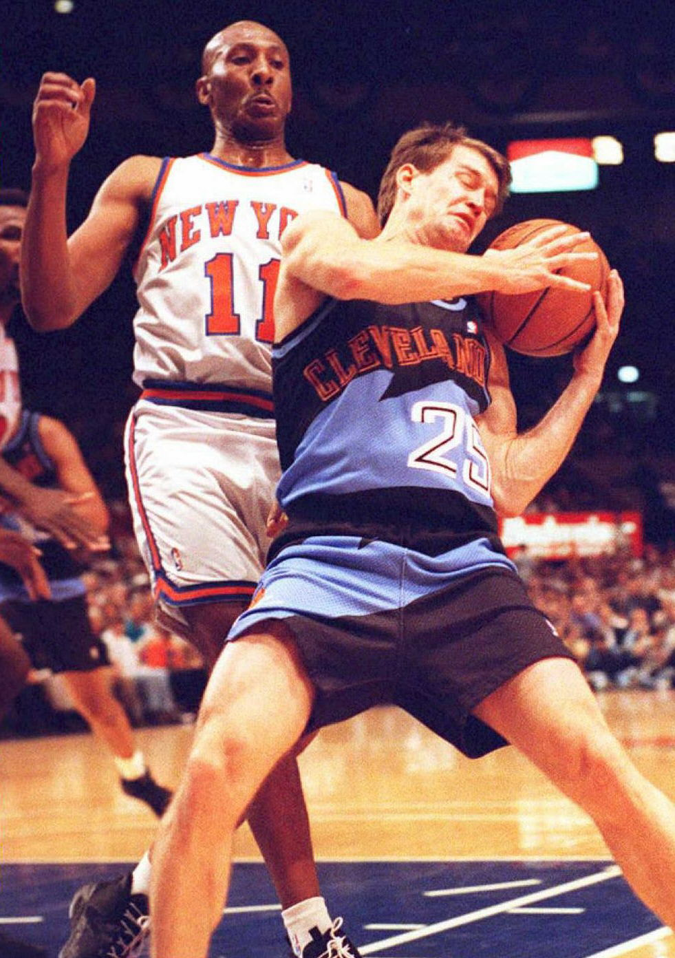 Even Mark Price's sweet shooting stroke couldn't make these jerseys look good. He can't even bare to look down at his own jersey.