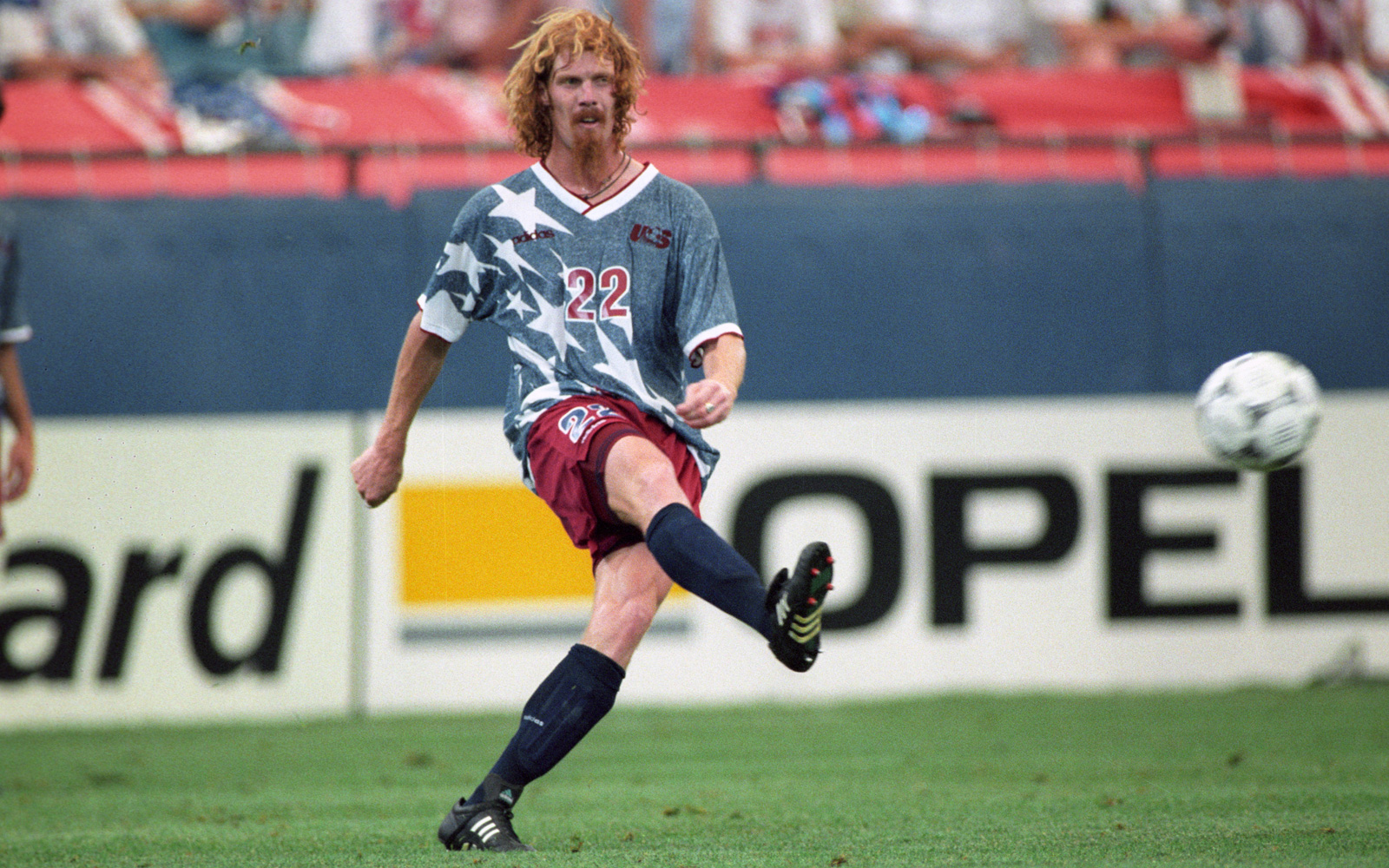 Alexi Lalas passes the ball upfield vs. Switzerland.
