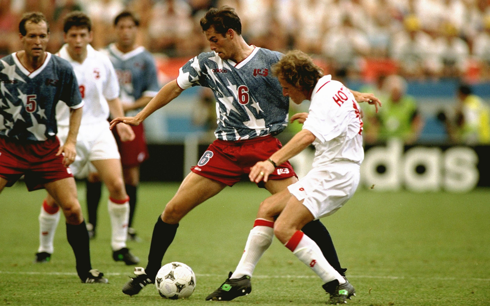 John Harkes fends off Switzerland's Marc Hottiger.