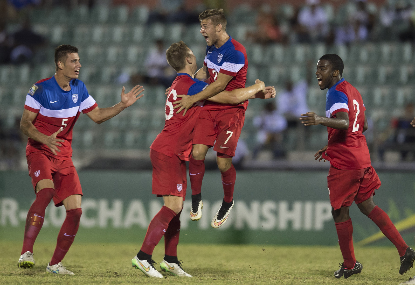 Paul Arriola (7) celebrates his goal in a World Cup qualifying playoff match vs. El Salvador. The U.S. U-20s cemented their place in the World Cup with a 2-0 win. They drew host New Zealand, Ukraine and Myanmar in their summer group.