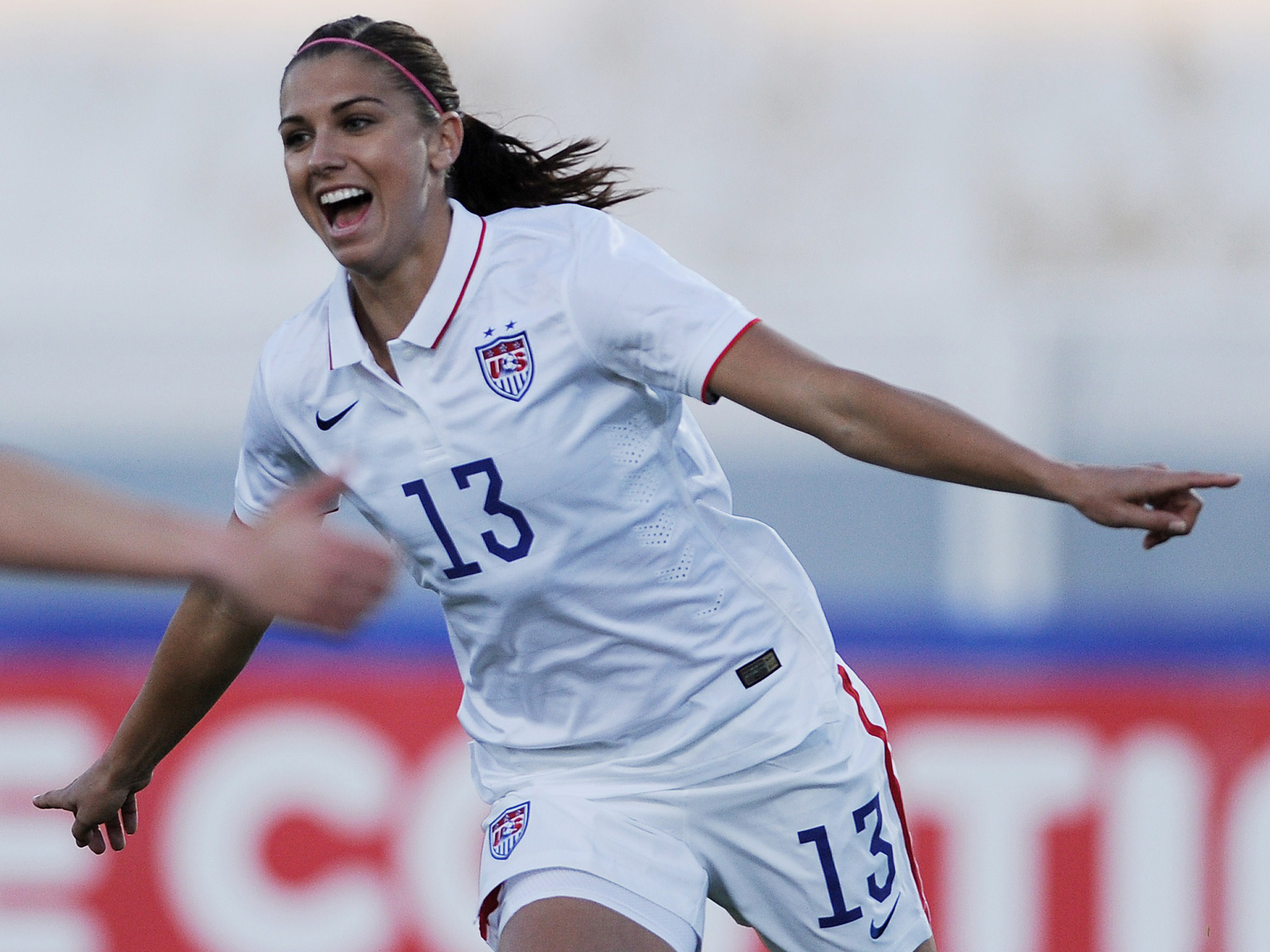 Alex Morgan celebrates her goal in the USWNT's 3-0 win over Switzerland in the Algarve Cup group stage.