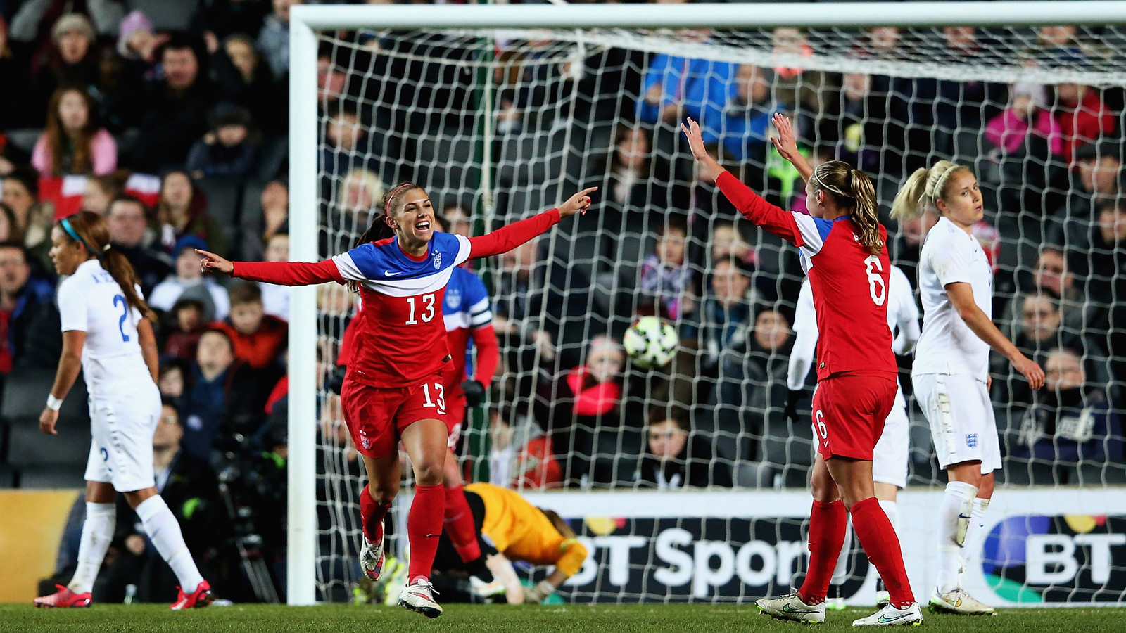 Alex Morgan celebrates scoring the lone goal in the USWNT's 1-0 win over England in a friendly at Stadium mk in Milton Keynes.