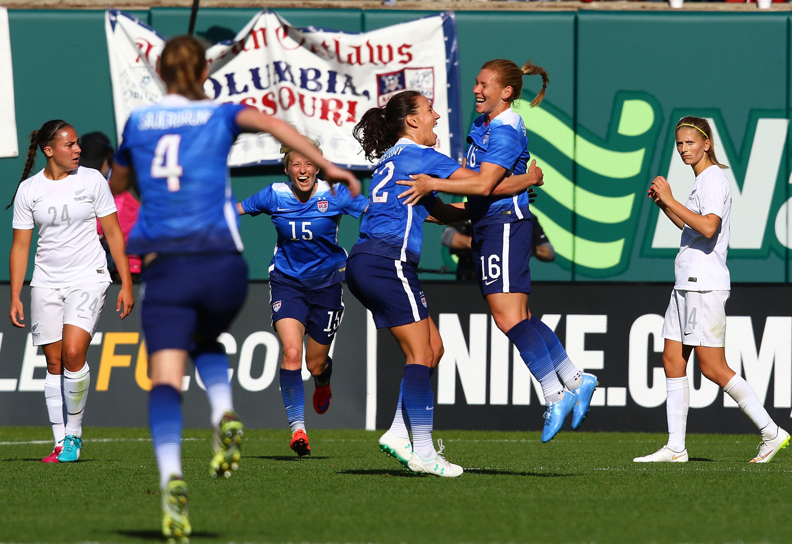 Lori Chalupny (16) celebrates her goal vs. New Zealand with Lauren Holiday at St. Louis's Busch Stadium. The goal opened the floodgates for a late outburst en route to a 4-0 U.S. victory in front of more than 35,000 fans.
