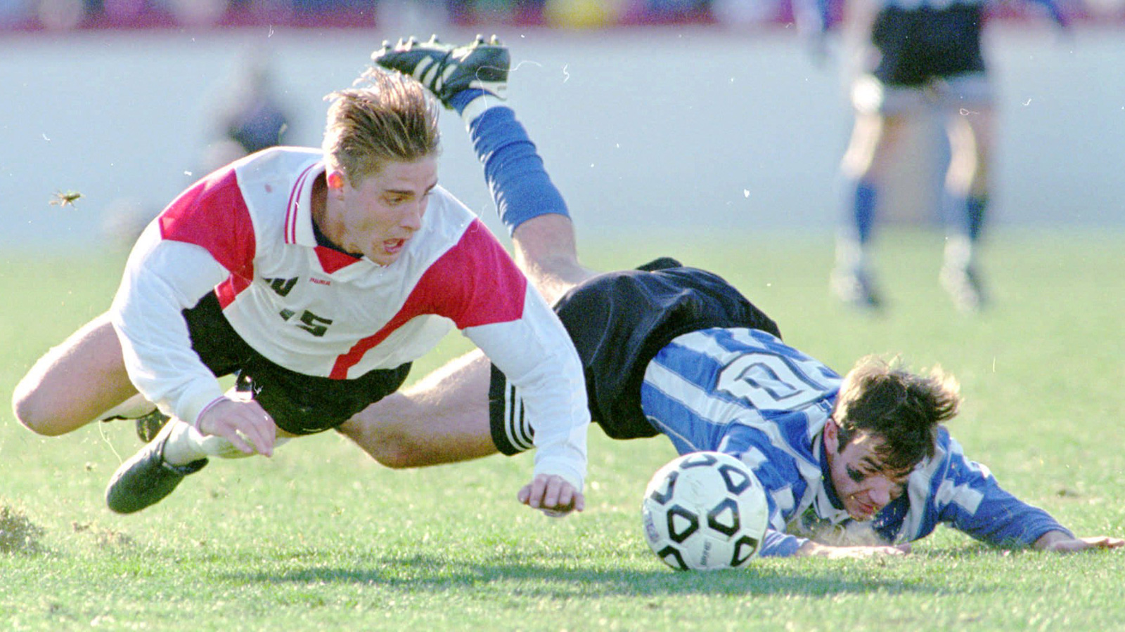 Duke defender Sam Smith (right hits the ground along with Wisconsin midfielder Shea Huston during the first half.