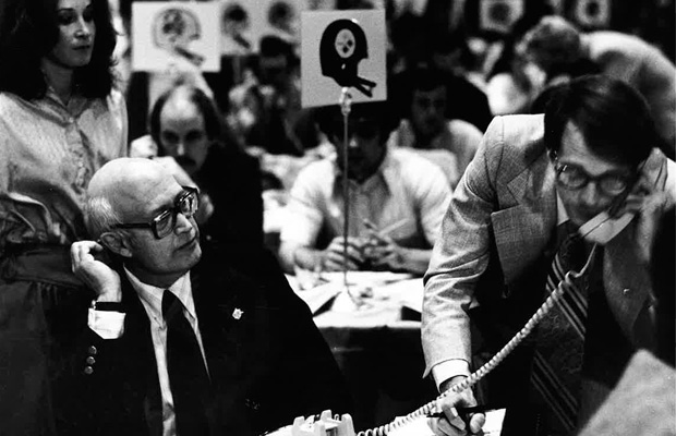 Bussert (right) works the phones at the 1979 NFL draft at the Waldorf Astoria hotel.