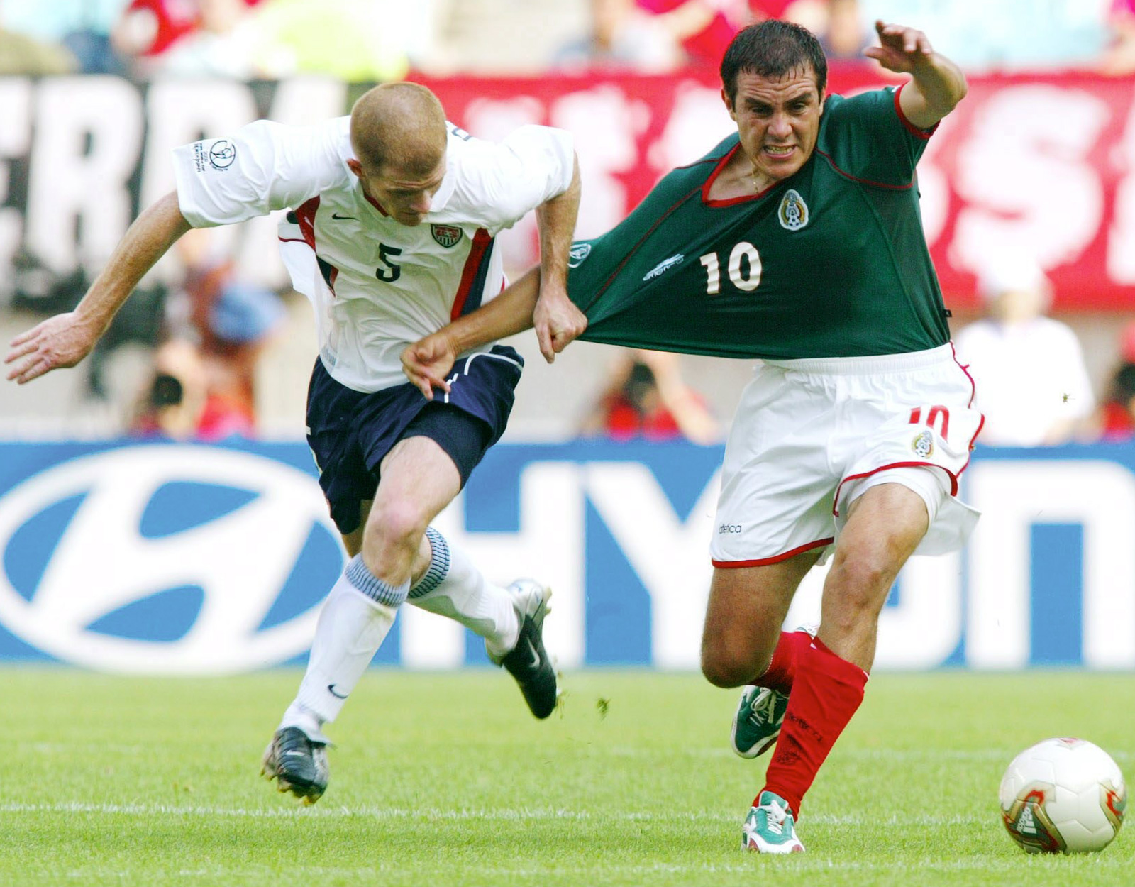 Blanco and John O'Brien tussle for the ball in the 2002 World Cup round of 16, a match the Americans won 2-0.