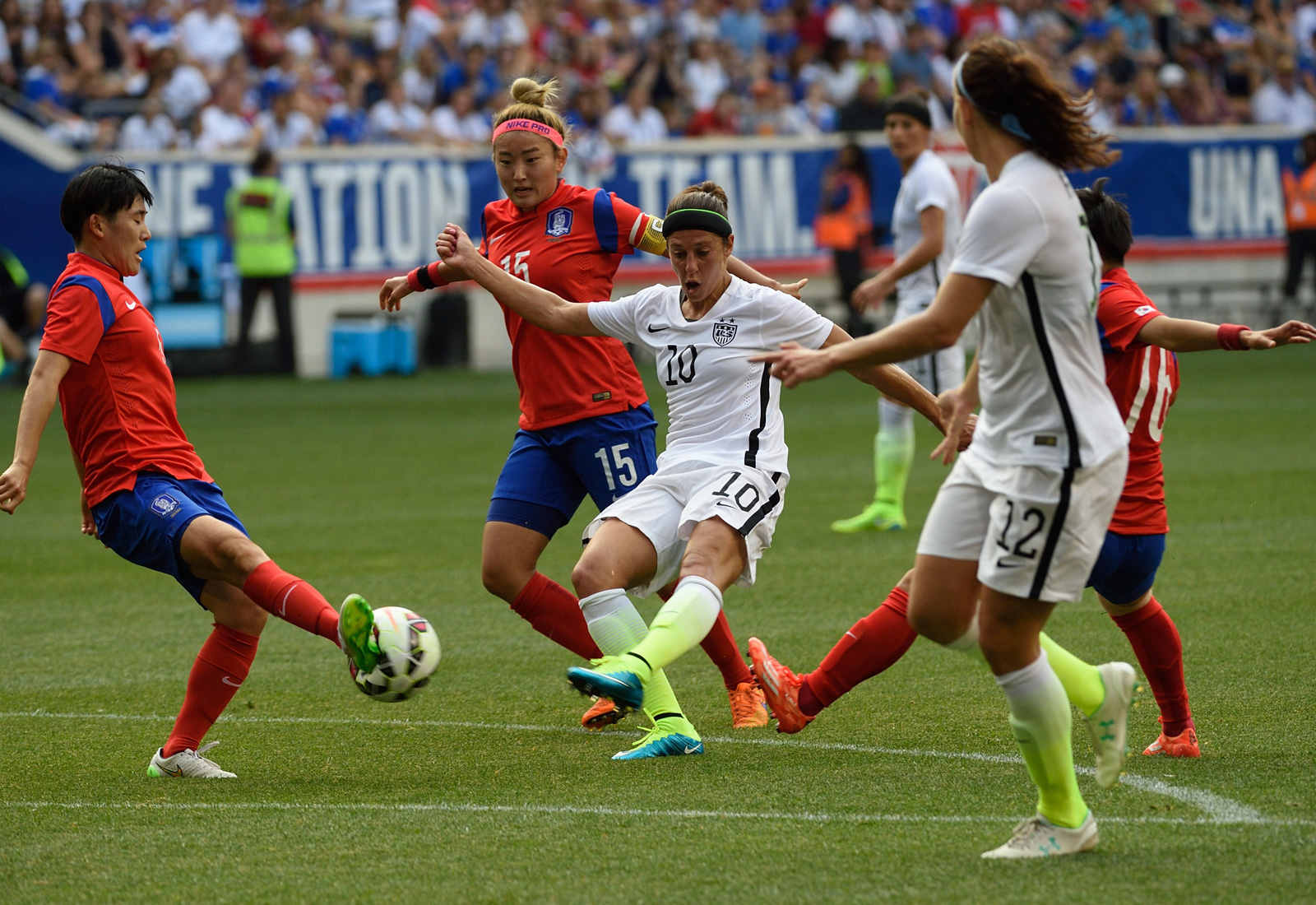 Carli Lloyd gets off a shot through traffic in the USA's final World Cup send-off friendly, a 0-0 draw against South Korea at Red Bull Arena.