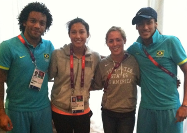 Brazil's Marcelo, Neymar pose with the USA's Christen Press, Meghan Klingenberg at the 2012 Olympics in London.